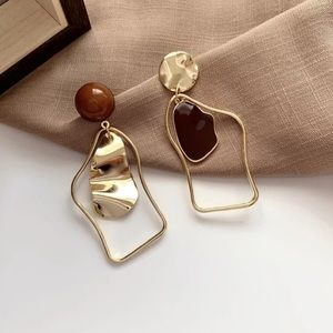Gold Tone Asymmetrical Earrings